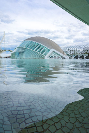 Hemispheric building in the sciencies and arts city in Valencia Hemispheric Building In The Scie Hemispheric Building In The Sciencies And Arts City In Valencia Modern Architecture SPAIN Valencia, Spain Water Reflections Architecture Building Exterior Built Structure City Cloud - Sky Day Love Architecture Nature No People Outdoors Pattern Pool Reflection Sciencies And Arts City In Valencia Sky Tourism Travel Travel Destinations Water