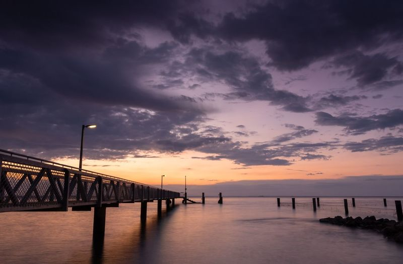 Amity Jetty Sky Water Cloud - Sky Sea Sunset Beauty In Nature Scenics - Nature Architecture Built Structure Nature Bridge - Man Made Structure Connection Dusk Tranquility Bridge Tranquil Scene Dramatic Sky Horizon No People Horizon Over Water