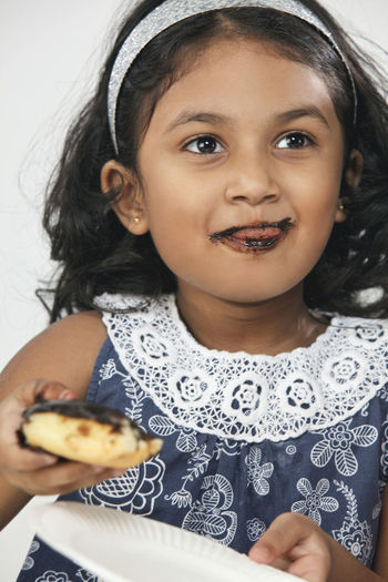 malaysia indian girl eating chocolate donut Asian  Chocolate Eating Females Food And Drink Happiness Indian Innocence Messy Cute Delicious Donut Elementary Age Enjoy Food Girl Headshot Leisure Activity Lifestyles Malaysia One Person Real People Smiling Studio Shot Table