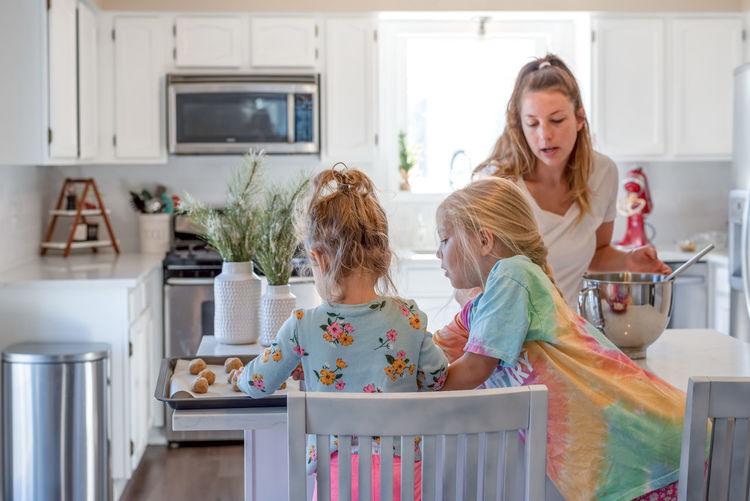 Women in kitchen at home