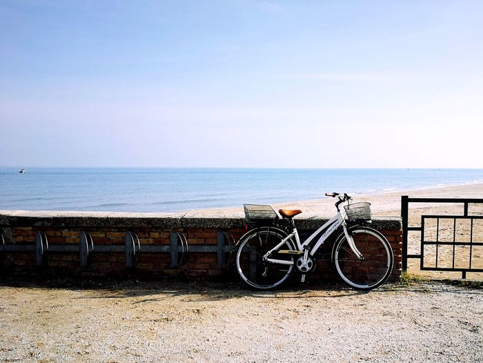 Dove sarà? Bicycle Sea Beach Horizon Over Water Water Sky Transportation Mode Of Transport No People Day Tranquility Outdoors Stationary Sand Nature Scenics Bicycle Rack