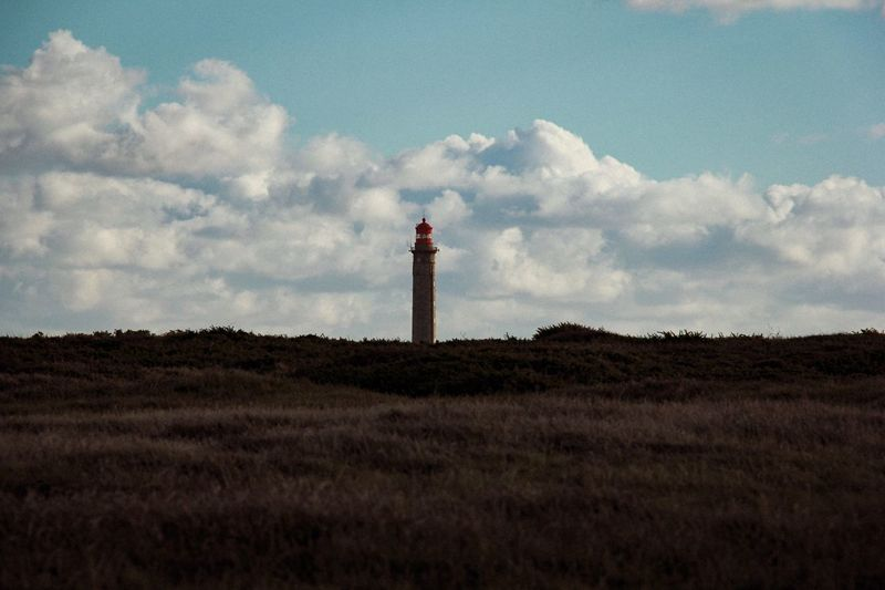 Lighthouse serenity Lighthouse Sky Standing Cloud - Sky Tower Nature One Person Land Tranquility Tranquil Scene Scenics - Nature Landscape Field Architecture Non-urban Scene Outdoors Day Environment