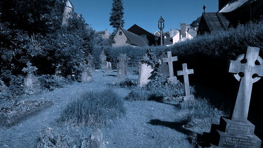 Architectural Column Architecture Blue Built Structure Church Yard Day Forgotten Things Grave Stone Grave Yard Head Stones Nature No People Outdoors Overgrown Sky Sunny Tourism Travel Destinations