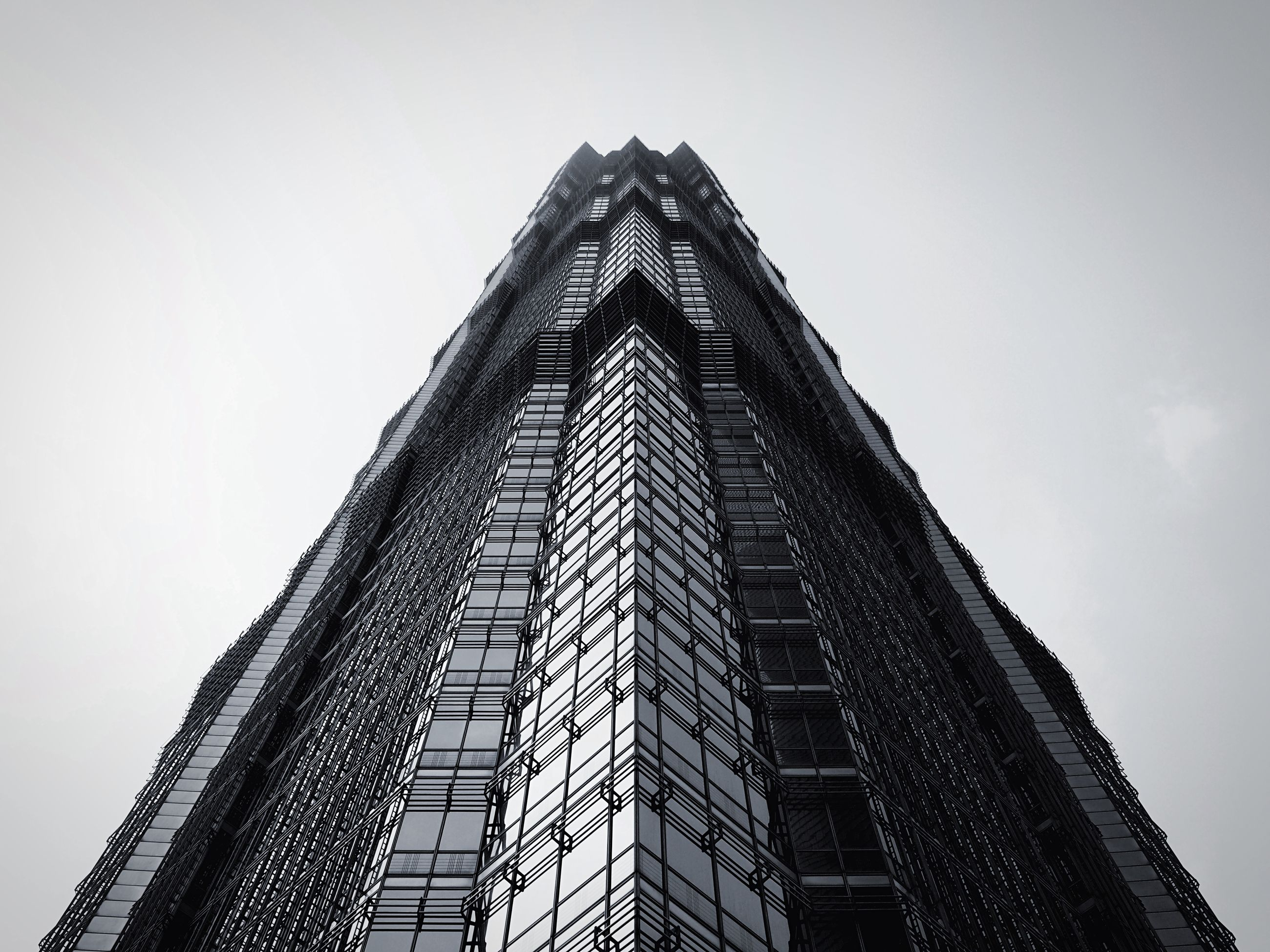 architecture, built structure, low angle view, building exterior, tower, clear sky, tall - high, city, famous place, skyscraper, sky, travel destinations, international landmark, modern, capital cities, tall, outdoors, architectural feature, day, no people