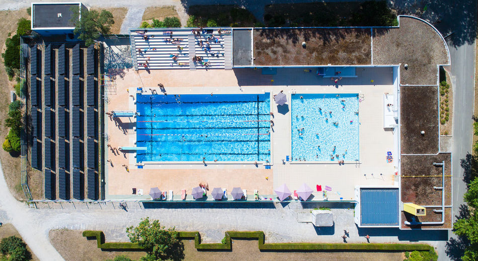 Aerial view on La Charbonniere public swimming pool, in Ancenis, France. Aerial Photography Aerial View Ancenis Blue Water Building Charbonniere City EyeEm Best Shots EyeEm Selects France Landmark Loire Atlantique Natation  Piscine Public Summer Swimming Pool Water