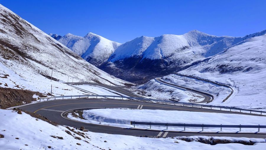 on the road Mountain Snow Winter Winding Road Blue Beauty In Nature High Angle View Road Outdoors Mountain Range Landscape Sky Clear Sky Scenics Nature Cold Temperature