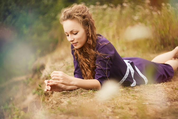 Beautiful Woman Beauty Beauty In Nature Casual Clothing Day Field Grass Leisure Activity Lifestyles Nature One Person Outdoors People Real People Selective Focus Sitting Smiling Young Adult Young Women