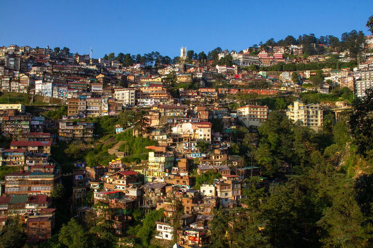 Mountainside view of shimla in the himalayas, india with christ church visible as the highest point
