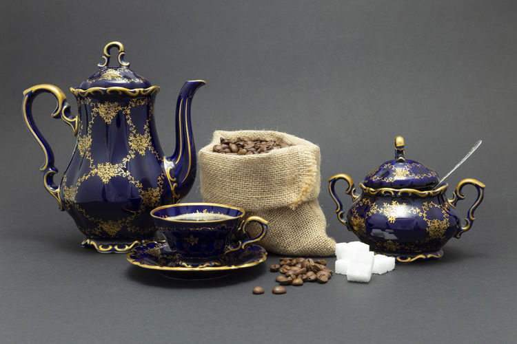 Close-up of tea served on table against black background