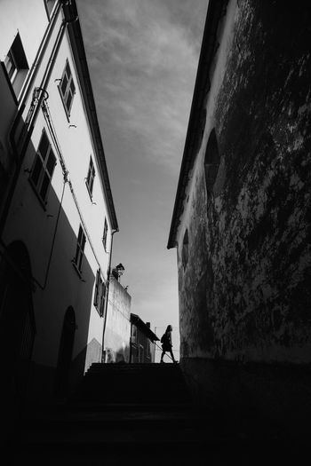 Corniglia, Cinque Terre Architecture Architecture And People Italy Cinque Terre Tinypeopleinbigplaces Blackandwhite Black & White Black And White Street Photography Strideby Silhouette Sky Architecture Building Exterior Built Structure Cloud - Sky