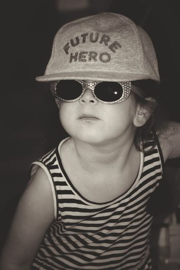 Portrait of cute boy wearing sunglasses and cap