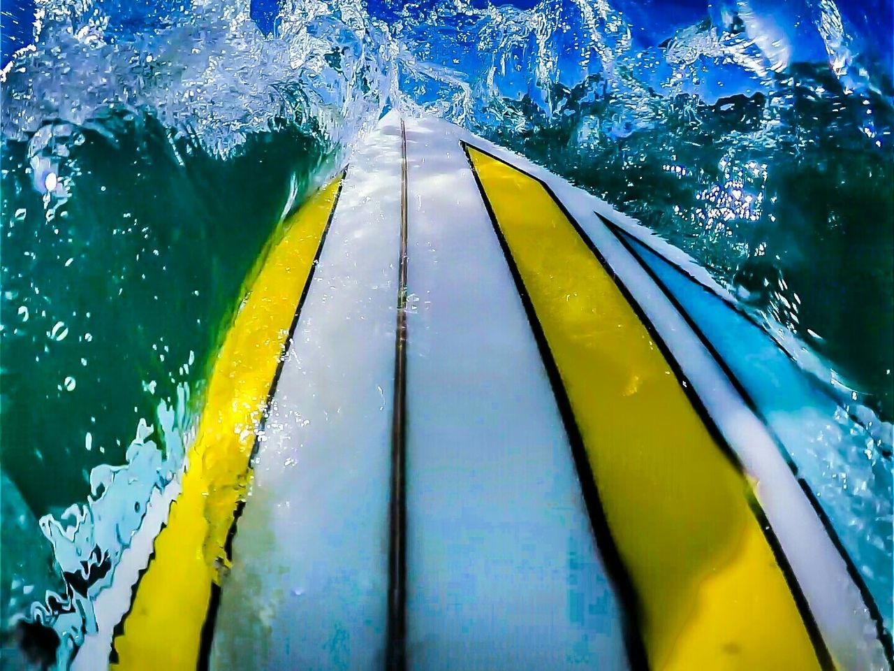 Cropped Image Of Surfboard In Sea