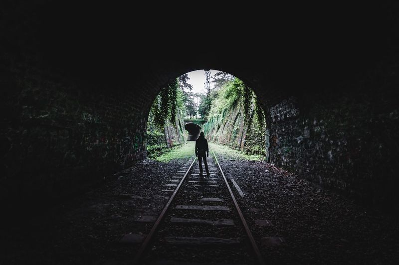 Darkness end Tunnel Vision Tunnel Explorer Urbanexploration Exploring Abandoned Places Abandoned Rail Transportation One Person The Way Forward Direction Real People Tunnel Architecture Full Length Transportation Built Structure