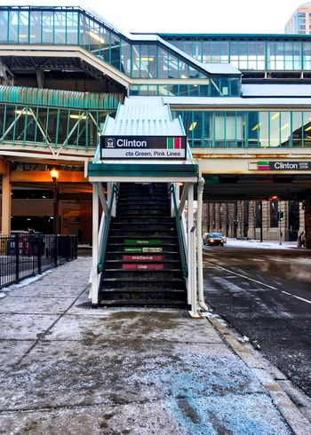 View of el train stairway and ramp to pink and green lines of Chicago's CTA transit system, on a snowy day in winter. Chicago Chicago El Chicago Loop Clinton Street Downtown Chicago Elevated Track Stairs Stairway Transit Transportation Winter Architecture Bridge - Man Made Structure Building Exterior Built Structure Commute Commuter Train El Train Outdoors Public Transportation Ramp Snow Stairwell Text Transportation