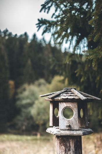 Close-up of old birdhouse on field