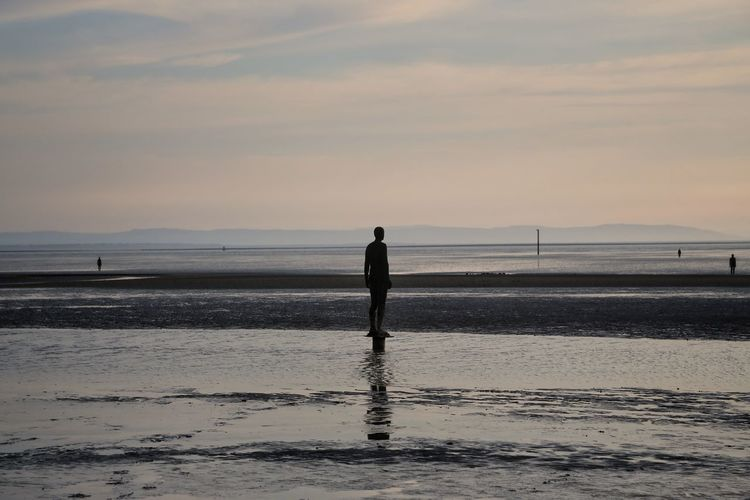 Crosby Beach Sky Scenics - Nature Water Beauty In Nature Sea Nature Crosby Beach Beach Land Real People One Person Standing Sunset Silhouette Full Length Tranquility Lifestyles Rear View Tranquil Scene Leisure Activity Horizon Over Water