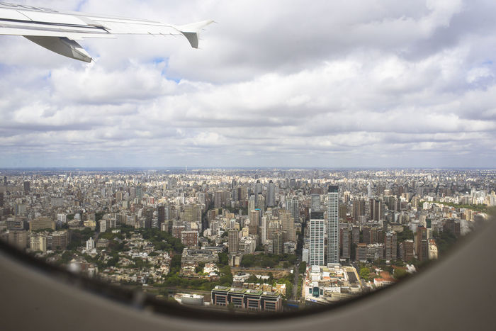 Landing This Is Latin America Travel Air Vehicle Airplane Architecture Argentina City Cityscape Cloud - Sky Flying Landscape No People Residential District Sky Skyscraper South America View From Above A New Beginning