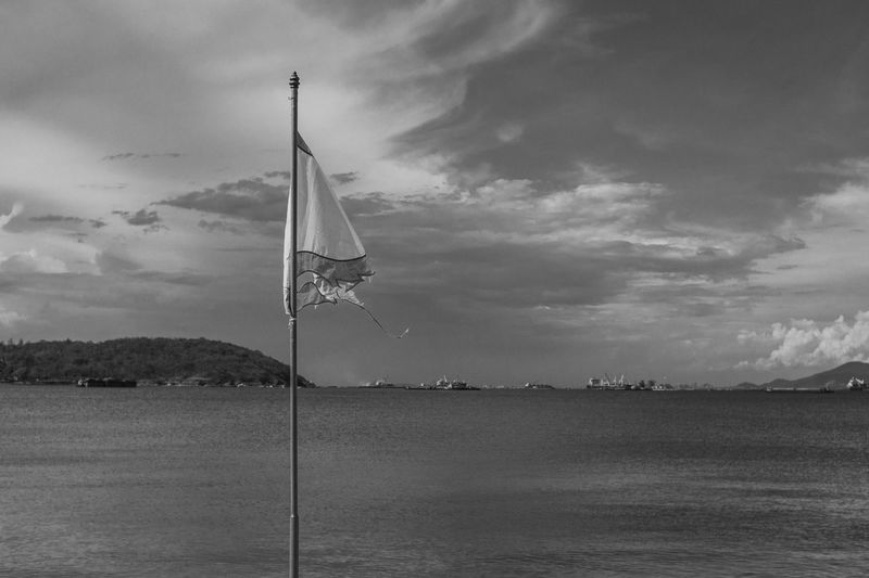 Flag on ship by river