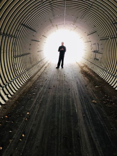 Real People One Person Full Length The Way Forward Lifestyles Direction Walking Outdoors Tunnel