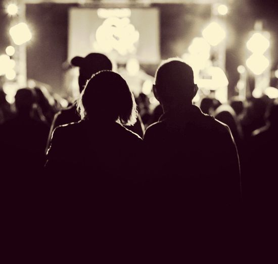Silhouette people at music concert
