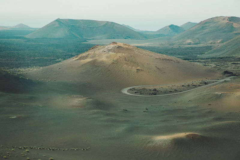 Aerial view of volcanic landscape and crater