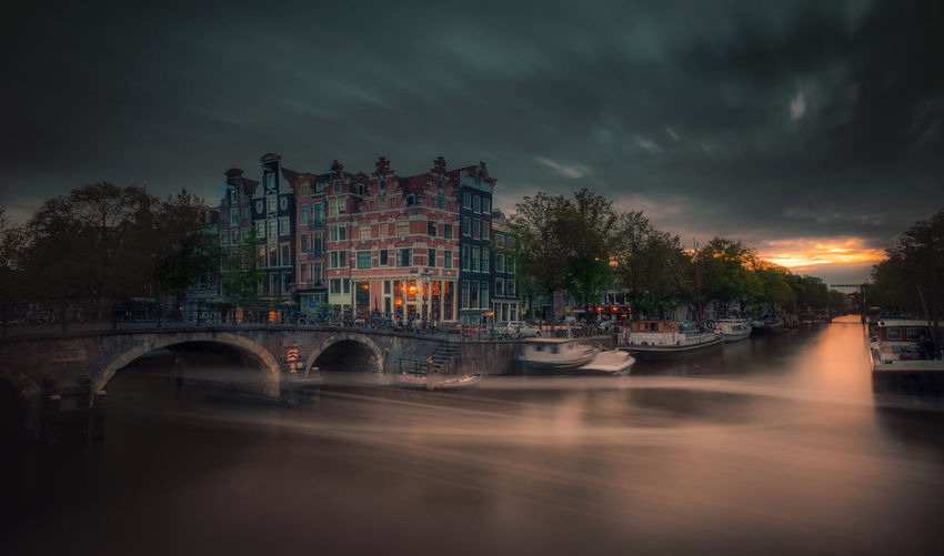 Amsterdam Architecture Built Structure Sky Water Cloud - Sky Mode Of Transportation Transportation Nautical Vessel Building Exterior Nature Bridge Overcast Bridge - Man Made Structure Building City River No People Connection Outdoors Arch Bridge Remo SCarfo EyeEm Best Shots EyeEmNewHere Dutch Holland