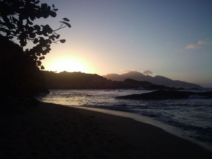 Going down sun in the early evening Beach Beauty In Nature Calibishie Calm Coastline Dominica Idyllic Island Life Mountain Nature No People Orange Color Outdoors Scenics Sea Shore Sky Sunset Tourist Attraction  Tranquil Scene Tranquility Travel Destinations Water