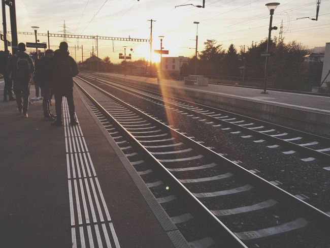Transportation Railroad Track Real People Public Transportation Rail Transportation Railroad Station Platform Railroad Station Cable Men Mode Of Transport Sky Travel Train - Vehicle Electricity Pylon Women Lifestyles Built Structure Sunset Standing Outdoors Be. Ready. EyeEmNewHere