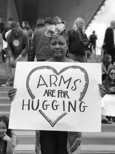 Armed. March For Our Lives 2018. Hug Woman Sign Blackandwhite Signs USA March For Our Lives Gun Control Blackandwhite Photography Black And White Photography Black And White Text Communication Western Script Real People Sign Incidental People The Troublemakers Group Of People Message Information Sign Placard The Street Photographer - 2018 EyeEm Awards The Photojournalist - 2018 EyeEm Awards