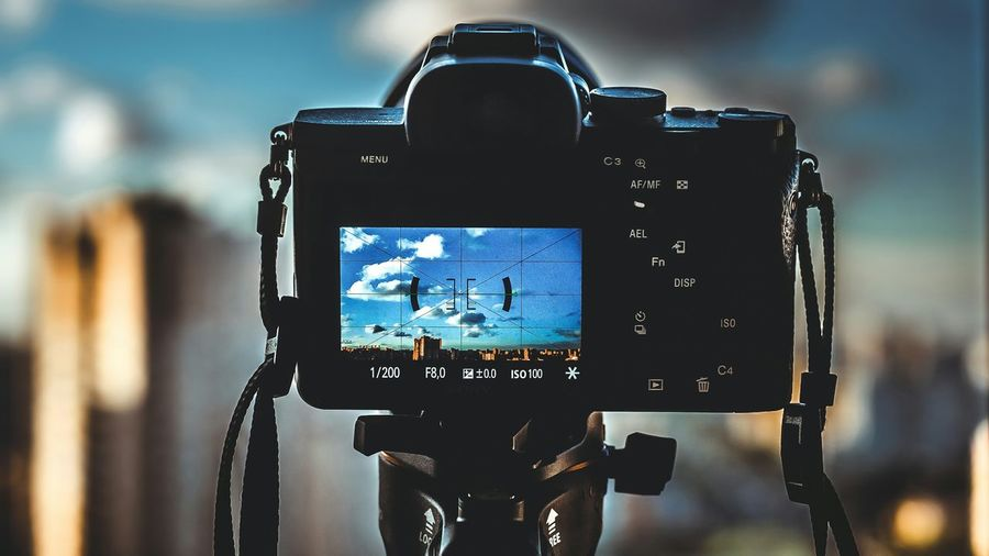Close-Up Of Camera Photographing Sky