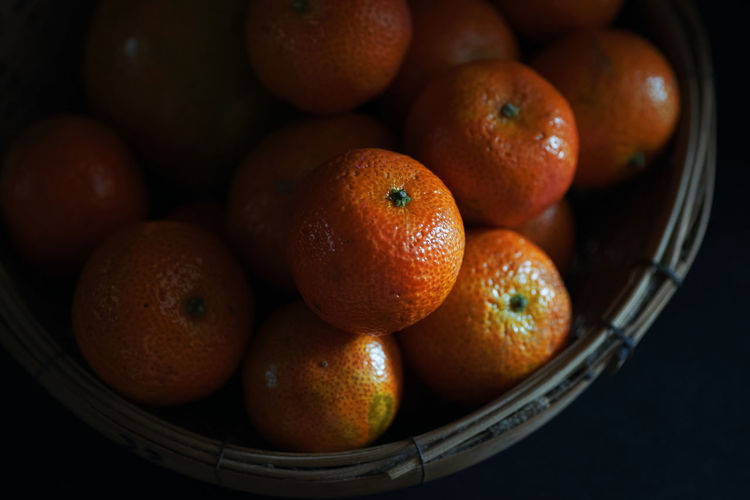 High angle view of orange in basket