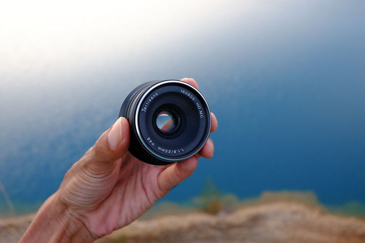 The Lens EyeEmNewHere 7artisans Human Body Part Human Hand Holding Photography Themes Camera - Photographic Equipment One Person Day Photographing Technology Photograph Sky