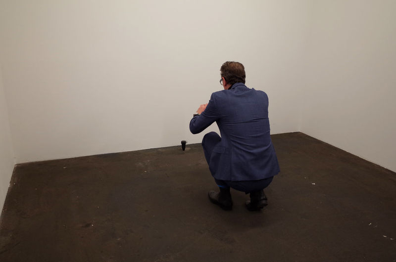Rear view of man standing on wall