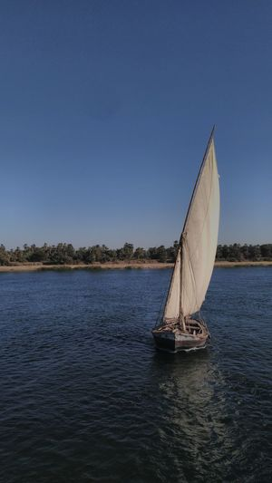 Boat Sailboat Water Reflection Blue Clear Sky Outdoors Yachting Nature That's Me Taking Photos Enjoying Life Hello World Vacations Aswan,Egypt Nile Boats Beauty In Nature Travel Destinations Landscape