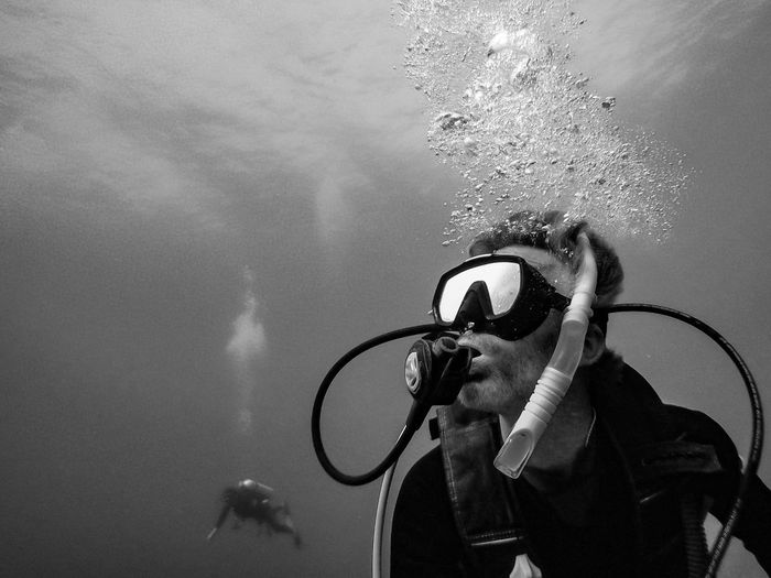 Man scuba diving in sea