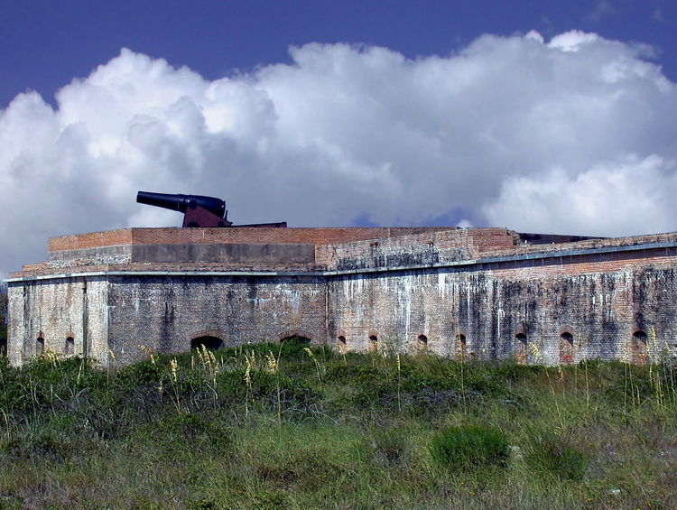 View of the Tower Bastion from outside Fort Barrancas Architecture Building Exterior Built Structure Cloud Cloud - Sky Cloudy Day Deterioration Exterior Field Florida Travel Fort Pickens Grass Grassy Green Color Growth Landscape Nature No People Old Outdoors Run-down Rural Scene Sky