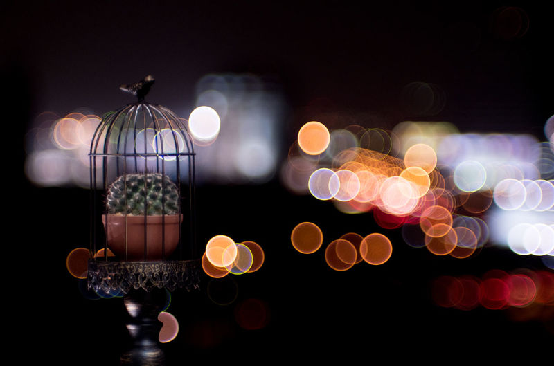 Close-up of illuminated lantern against black background