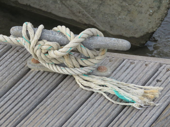 High angle view of rope tied on cleat