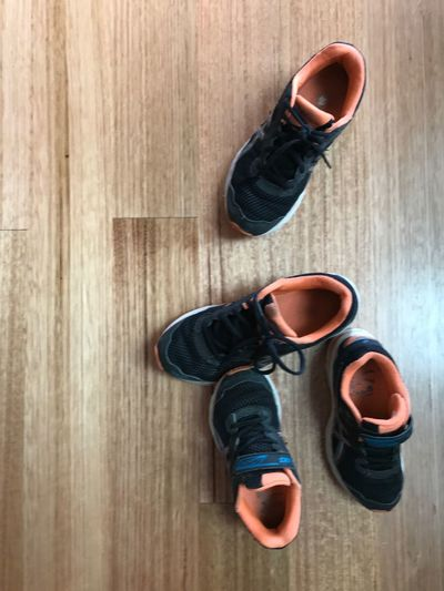 Canvas Shoe Day Found Objects High Angle View Indoors  Kids Shoes Kids Sneakers Lifestyles Looking Down No People Orange Sneakers Pair Shoe Sneaker Sneakers Wood - Material Wooden Floor Wooden Flooring