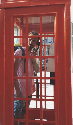 Man talking in telephone booth