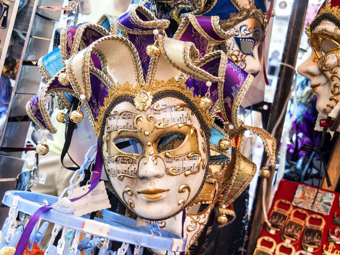 Close-up of venetian masks for sale in store
