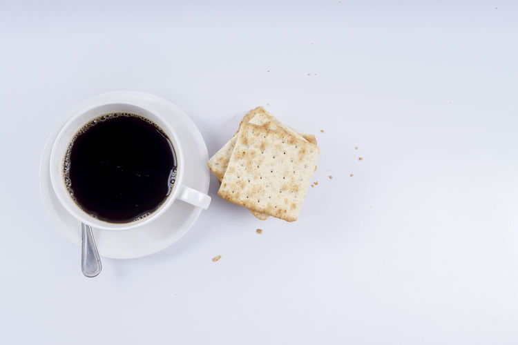 COFFEE AND BISCUIT ISOLATED ON WHITE Breakfast Close-up Coffee - Drink Coffee Cup Day Directly Above Drink Food Food And Drink Freshness Indoors  No People Refreshment Studio Shot Table