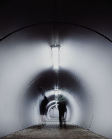 Tunnel Arch Indoors  Architecture Direction The Way Forward Blurred Motion Motion Built Structure One Person Transportation Real People Unrecognizable Person Day Connection on the move Rear View Walking Arched Shadow
