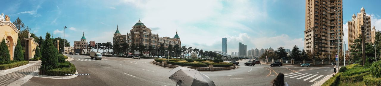 Dalian, Liaoning, China 2017 MelbournePhotographer IPhoneography Mobilephotography Streetphotography Adobelightroommobile Vscocam Panorama Architecture Built Structure Building Exterior Sky City Road Land Vehicle Transportation Car Cloud - Sky Day Street Mode Of Transport Outdoors Panoramic Skyscraper City Life Travel Destinations Tree