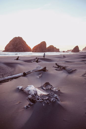 Beach (find me on IG @noeldxng) Beach Sand Sea Outdoors Silhouette Nature Tranquility Travel Destinations One Person Landscape Perspectives On Nature Tranquility Aerial View The Week On EyeEm Warm Oregon Oregon Coast Be. Ready. Go Higher A New Beginning Capture Tomorrow