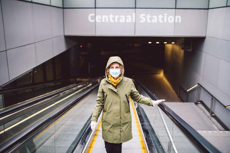 Portrait of man standing on escalator at subway station