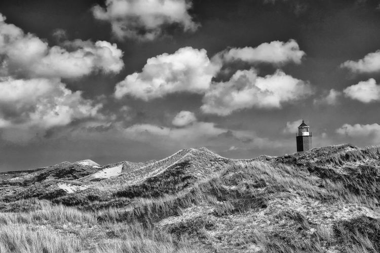Architecture Protection Nature Blackandwhite Sky Lighthouse Day Outdoors Tranquility Mountain Direction Travel Photography Sylt Scenics Beauty In Nature Guidance Safety Kampen No People Cloud - Sky Building Exterior Built Structure My Best Photo Tower Building Scenics - Nature Security Land Tranquil Scene