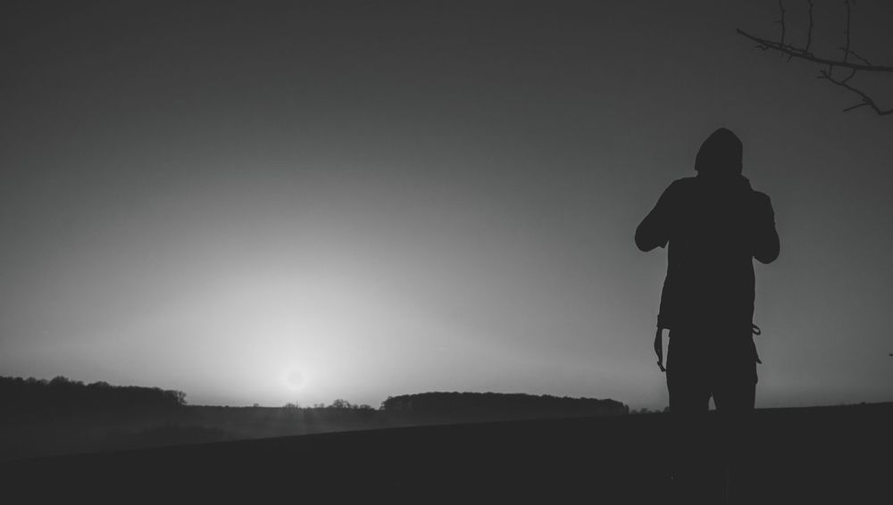 Real People Full Length Field Standing Silhouette One Person Clear Sky Leisure Activity Rear View Outdoors Nature Lifestyles Countryside Winter Tranquility Black And White