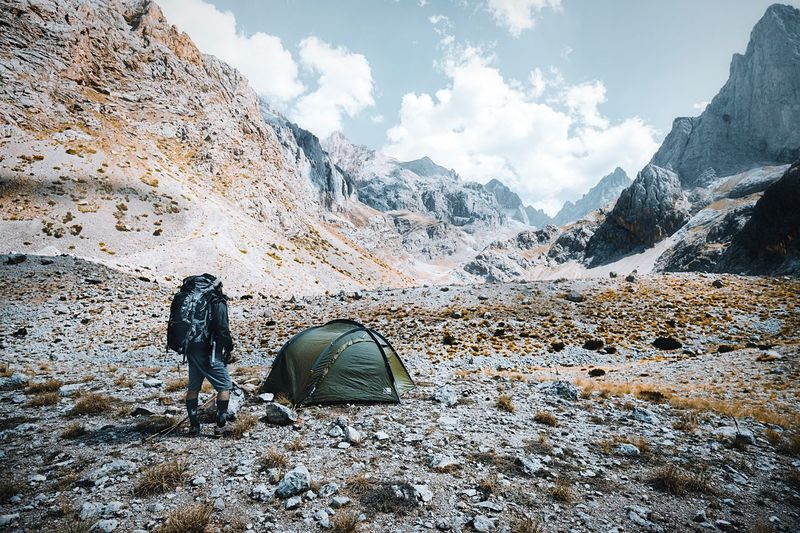 Camp site in the heart of the Taurus Mountain range EyeEm Selects Nature Snow Sky Mountain Beauty In Nature Day Cloud - Sky Cold Temperature Environment Scenics - Nature Winter Real People Outdoors Snowcapped Mountain Mountain Range People Men Leisure Activity Tranquility