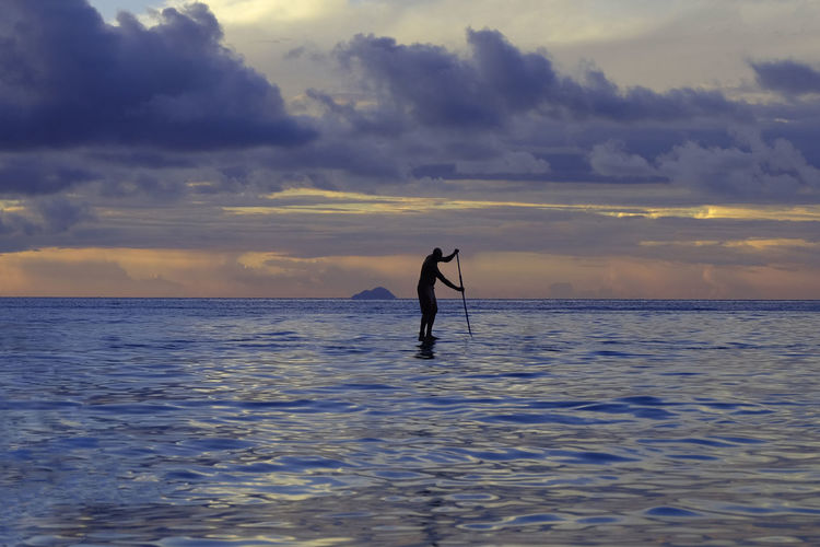 SAILING AWAY IN PARADISE Beauty In Nature Cloud - Sky Horizon Horizon Over Water Leisure Activity Lifestyles Nature One Person Outdoors Real People Scenics - Nature Sea Silhouette Sky Sport Sunset Tranquility Water Waterfront Inner Power